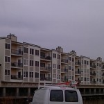 A view of the Edgewater Condominium Complex prior to Alside Sheffield vinyl replacement window installation.