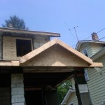 Fire restoration: New gable over front porch entrance completed.