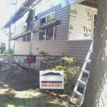 Fire restoration: New vinyl siding and replacement windows installed.