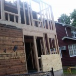 Fire restoration: New framing and second story addition at the rear of the home.