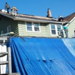 Installing new roofing shingles on the roof in Hawthorne, NJ.