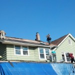 Installing ice and water shield on the roof before the new GAF Timberline shingles in Hawthorne, NJ.