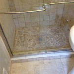 New shower base, tile, and tile floor installed.