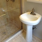 Original pedestal sink and faucet reinstalled.