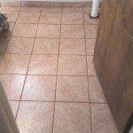 New tiles installed on the basement laundry room floor.