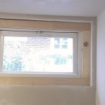 New trim has been installed around the basement window.