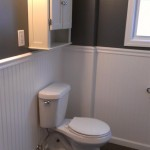 A view of the new toilet and cabinet above it.
