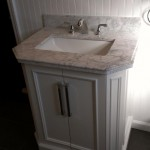 The vanity, faucet, and medicine cabinet installed.