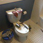 New comfort height toilet and floor tiles installed.