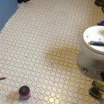 New floor tiles and door saddle installed.