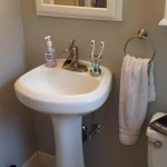 View of the original pedestal sink and tile floor.