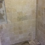 New shower base and wall tile installed.