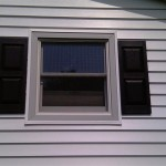 After installation of new Prodigy siding and shutters.