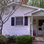Another satisfied customer after installation of new siding.