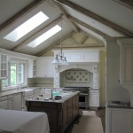Renovated kitchen with exposed beams, skylights, and custom cabinetry.