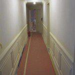 Custom millwork paneling in the hallway.