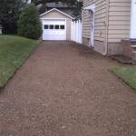 After removing the driveway, waiting for the stone to settle before paving.
