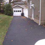 New asphalt driveway.