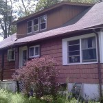 Before installing new roofing, windows and Alside siding in Hewitt, NJ.