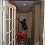 Painting a hallway in the home.