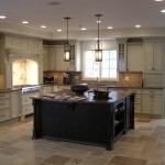 Custom kitchen with granite countertops and beautiful cabinets.