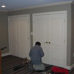 Installing door knobs on new custom doors on the second floor.