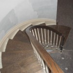 The completed custom curved staircase with railings.