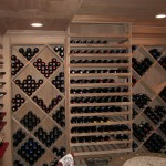 Custom cabinetry installed by M&M Construction Specialist in the wine cellar. Includes HVAC controls.