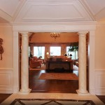 Entry foyer with custom millwork and perma-cast columns.