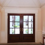 Interior foyer with custom entry doors.