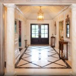 Entry foyer with marble floors and columns.