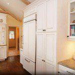 Custom kitchen cabinets and granite countertops.