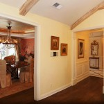 View of open floor plan between kitchen and formal dining room.