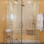 Finished master bathroom with glass shower doors and mosaic tile.