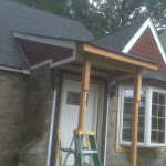 Building a new front porch overhang and new Anderson bay window.