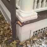 Damaged historic wood porch.