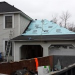 New shingles and deck armor being installed.