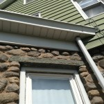 Detail of the 100+ year old stonework and modern soffit on this home in Hawthorne, NJ.