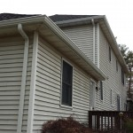 A view of new gutters installed at the rear of the home.