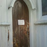 The side entrance door to St. Peter's Episcopal Church in Spotswood, NJ before restoration.