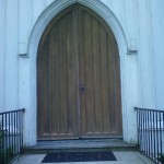 The main set of doors on St. Peter's Episcopal Church in Spotswood, NJ prior to restoration.