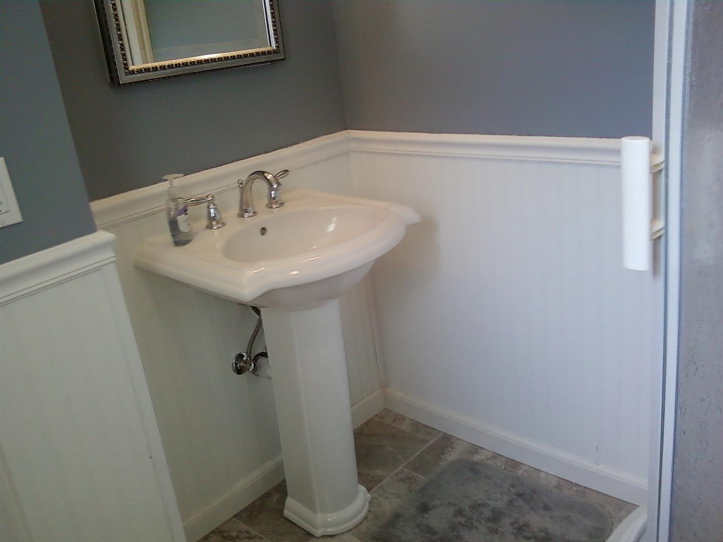 new pedestal sink installed in bathroom during renovation in westfield