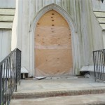 The doors have been removed and temporary plywood blocks this entrance in Spotswood, NJ.