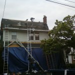 Removal of the old shingles and new plywood has been installed along the lower roof in Summit, NJ.