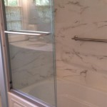 The shower completed with new glass doors, marble tiles, and a grab bar in Parsippany, NJ.