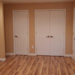 Doors and lighting completed in this basement in Chatham, NJ.