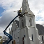 Work continues to repair the deteriorated wood moldings on the steeple tower in Spotswood, NJ.