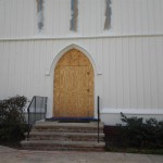 The lower section of the front of St. Peter's Episcopal Church has been painted. Soon the restored front doors will return!