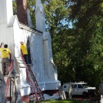 Prepping the side of St. Peter's Church for painting in Spotswood, NJ.