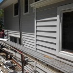 Finishing the new aluminum around the windows in Roseland, NJ.